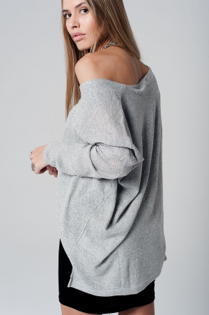 Jersey de manga larga gris claro con bajo asimetrico de punto de lurex plateado