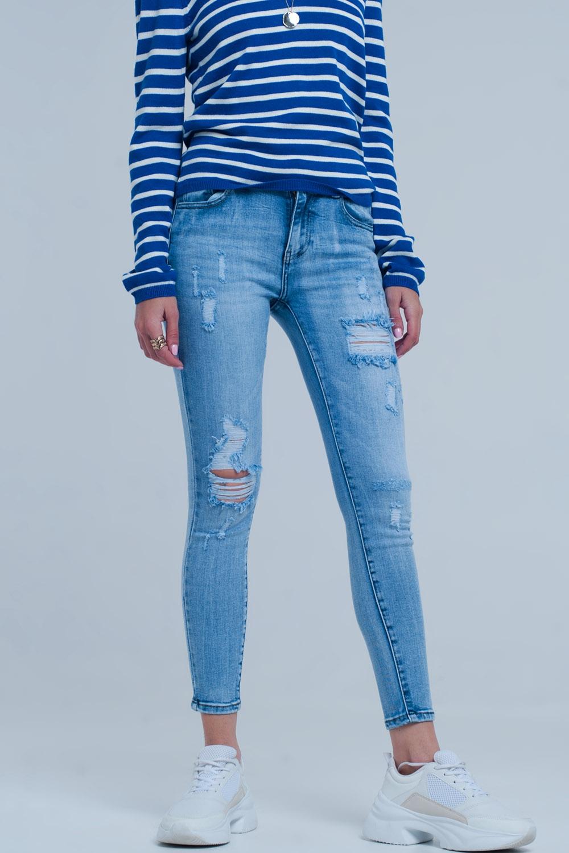 50e6743758 Vaqueros ajustados con lavado azul claro vintage y rotos marcados enlarge