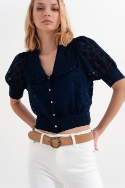 Navy blue polka dot blouse with bib collar and embellished buttons